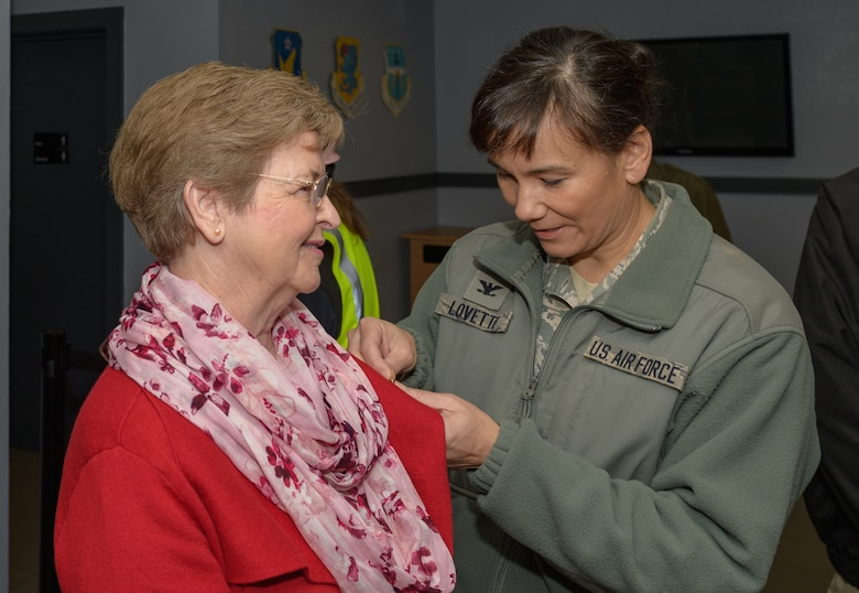 U.S. Air Force Col. Debra Lovette, 81st Training Wing commander, presents Ann Hamilton, Gold Star Family Member, with a Gold Star Family Member lapel pin inside the visitors center at Keesler Air Force Base, Mississippi, January 24, 2019. Hamilton's brother, Staff Sgt. James W. Davis, was killed in 1968 while conducting military operations in Vietnam . (U.S. Air Force photo by Andre' Askew)