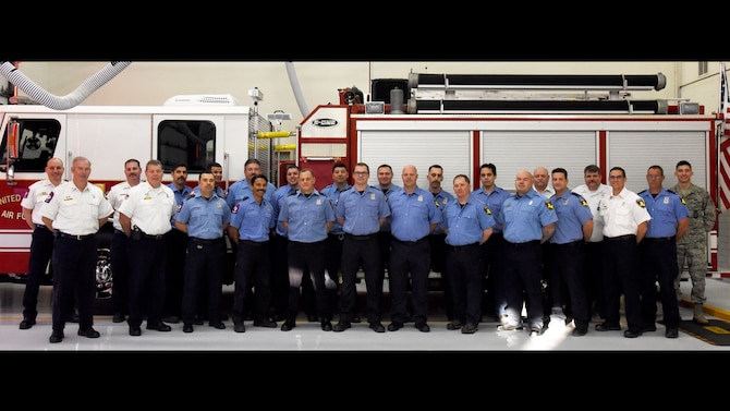 Members from Goodfellow's Fire Department stand together for a photo in the fire house on Goodfellow Air Force Base, Texas, Jan. 24, 2019. The Fire Department has won several awards for their pursuit of excellence, including the Small Fire Department of the Year award from the U.S. Air Force in 2017. (U.S. Air Force photo by Airman 1st Class Abbey Rieves/Released)