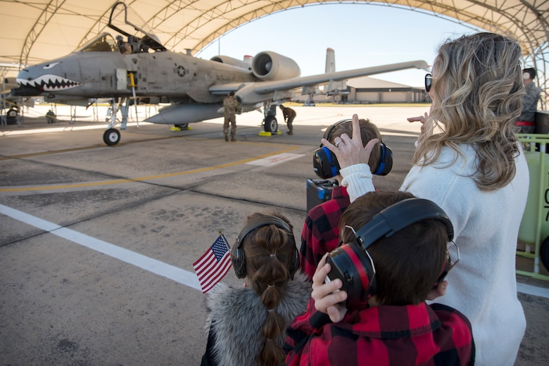 The Family of Lt Col. Sean Hall, 75th Fighter Squadron commander, prepare to greet him after returning from supporting Operation Freedom Sentinel, Jan. 25, 2019, at Moody Air Force, Ga. Reintegration events like these are especially important to Moody's Airmen and their families as Moody is the most deployed base in Air Combat Command. (U.S. Air Force photo By Airman First Class Eugene Oliver)