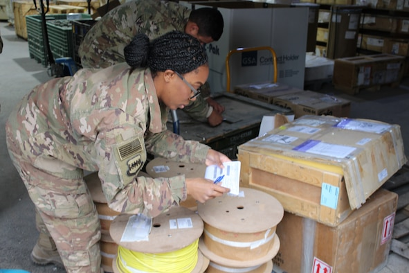 SOUTHWEST ASIA – Senior Airman Cheyenne Smith, 332nd Air Expeditionary Wing, 332nd Expeditionary Logistics Readiness Squadron customer service representative, checks the invoice numbers on an outgoing shipment at an undisclosed location, January 19.  At its busiest, the 332 ELRS moves over 4,500 personnel and 5,000 short tons (10 million lbs.) of cargo every 3-months. (US Air Force photo by Maj. John T. Stamm)