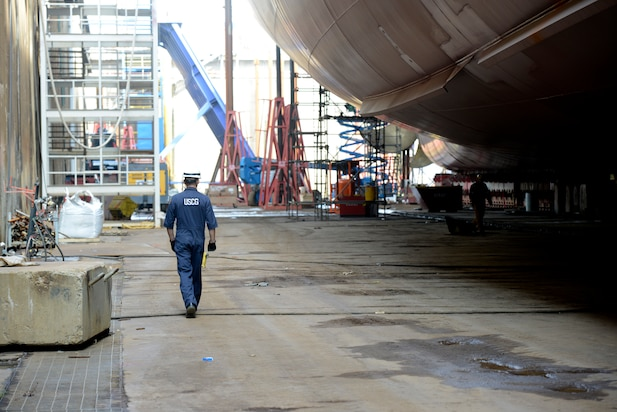 Lt. j.g. Ryan Thomas, a marine Inspector at Coast Guard Sector Delaware Bay, walks below the Kaimana Hila, an 850-foot container ship being constructed in Philadelphia Shipyards, Oct. 4, 2018.
