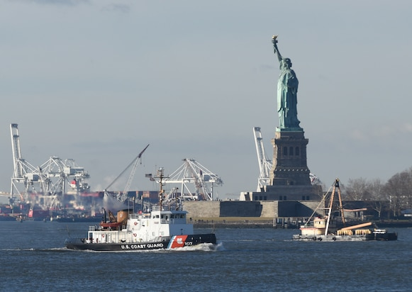 Coast Guard Cutter Penobscot Bay, a 140-foot domestic icebreaker homeported in Bayonne, New Jersey, transits the upper New York Harbor near the Statue of Liberty on the first day ice breaking season Monday, Dec. 17, 2018.