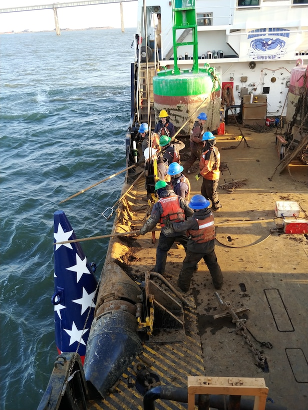 U.S. Coast Guard Cutter James Rankin crewmembers remove the Francis Scott Key buoy from the Patapsco River in Baltimore to prepare for the winter season, Dec. 3, 2018