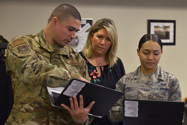 U.S. Air Force Tech. Sgt. Chance Pugh, Christine Seman and 1st Lt. Krystal Price, 335th Training Squadron manpower apprentice course students, discuss content to brief to the class at Keesler Air Force Base, Mississippi, Jan. 23, 2019. Students practice briefing often as it is a main requirement of the career field. (U.S. Air Force photo by Airman 1st Class Kimberly L. Mueller)