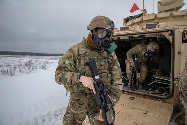 U.S. Army Cpl. Wendal Asberry, a Task Force Raider infantryman, dismounts a Bradley Fighting Vehicle during a training exercise for Operation Raider Lightning at Bemowo Piskie Training Area, Poland, Jan. 17, 2019. Raider Lightning is a series of live-fire training exercises, day and night, conducted to better enhance combat readiness operations in even the most inconvenient terrain and circumstance.