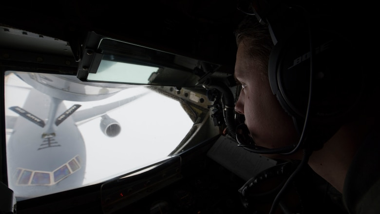 Airman 1st Class Tristen Lang, 384th Air Refueling Squadron in-flight refueling specialist, performs an in-flight refueling connection with a KC-46 Pegasus over Washington, January 22, 2019. A KC-135 Stratotanker crew trained on with the crew of the new KC-46 on mid-air refueling procedures of the KC-46, which can both receive and dispense fuel. (U.S. Air Force photo/Airman 1st Class Lawrence Sena)