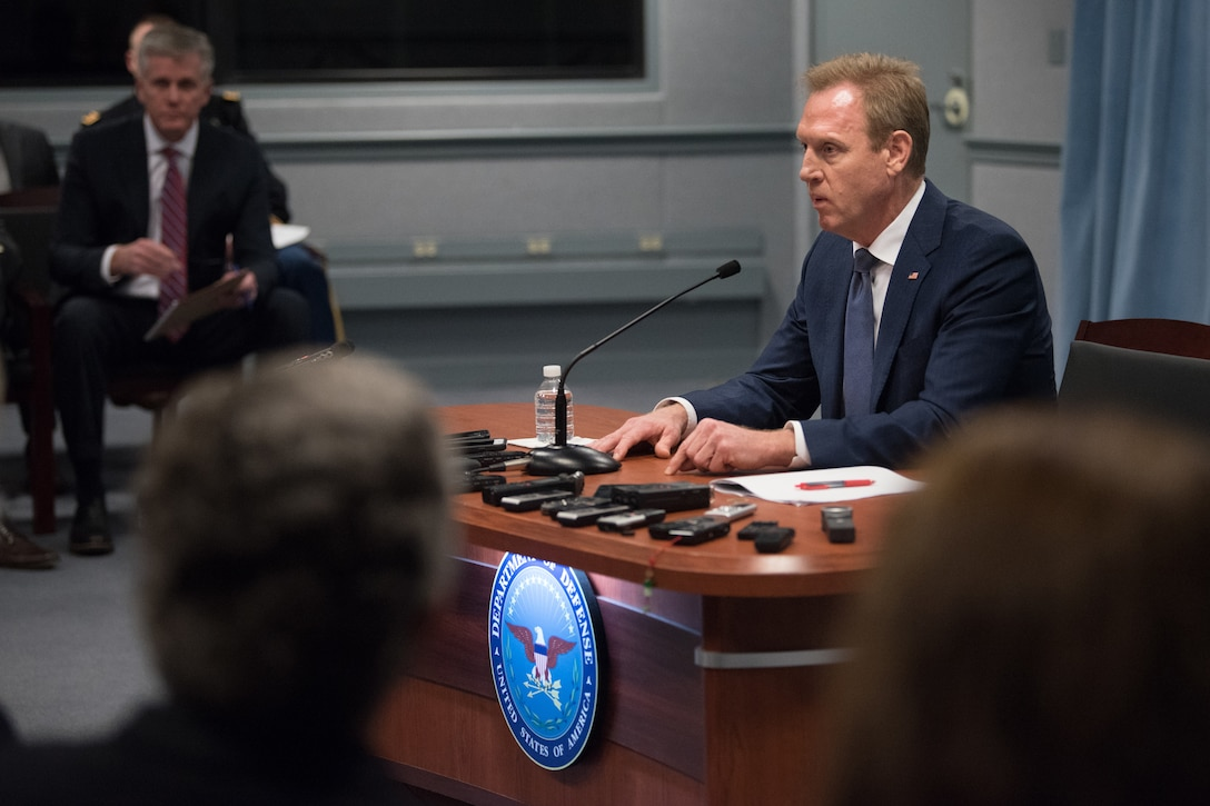 Acting defense secretary speaks at a news conference.
