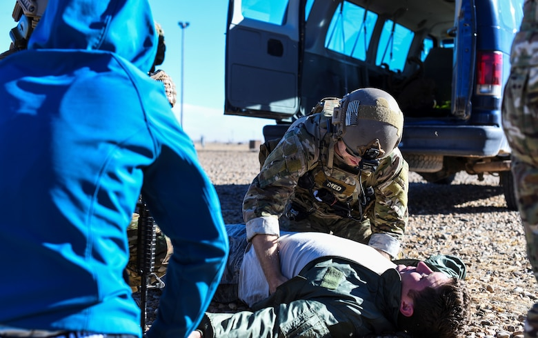 U.S. Air Force Staff Sgt. Andrew Thompson, 27th Special Operations Support Squadron SOF medical element, participates in a joint exercise with 27th Special Operations Civil Engineer Squadron firefighters at Cannon Air Force Base, N.M., Jan. 18, 2019. Responsibilities for SOFME include ensuring the health and well-being of operational members, conducting casualty evacuations, and providing medical expertise and advice to commanders. (U.S. Air Force photo by Senior Airman Lane T. Plummer)