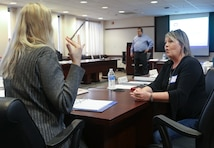 Savannah District Leadership Development Program Level 1 participants Heather Pacheco (left), Equal Employment Office, and Amy Capwell, Real Estate Division, engage in a discussion during one of the training breakout sessions.