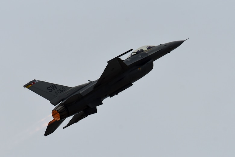 "U.S. Air Force Capt. Zoe ""SiS"" Kotnik, F-16 Viper Demonstration Team commander and pilot, performs a precision aerial demonstration over the flight line at Joint Base Langley-Eustice, Va., Jan. 28, 2019"