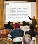 Brig. Gen. Joseph F. Shrader, commanding general, Marine Corps Logistics Command, discusses his fourth line of effort, team concept, during a town hall meeting with Marine Force Storage Center Marines and civilian-Marines, Jan. 14.