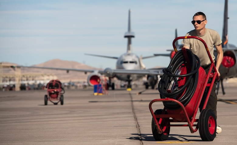 U.S. Air Force Senior Airman Dylan Sherrill, 20th Aircraft Maintenance Squadron, 79th Aircraft Maintenance Unit (AMU) crew chief, moves a flightline fire extinguisher during Exercise Red Flag 19-1 at Nellis Air Force Base, Nev., Jan. 28, 2019.