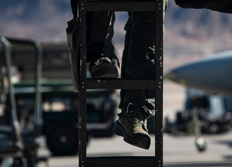 A U.S. Air Force pilot assigned to the 79th Fighter Squadron (FS) prepares to climb into an F-16CM Fighting Falcon during Exercise Red Flag 19-1 at Nellis Air Force Base, Nev., Jan. 28, 2019.