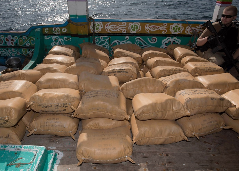 U.S. Navy Fire Controlman (Aegis) 2nd Class Wesley Helm, assigned to the guided-missile destroyer USS Chung-Hoon (DDG 93), watches a shipment of narcotics aboard a dhow that was discovered transporting 4,700 kilograms of hashish in the Gulf of Aden, Jan. 24, 2019. Chung-Hoon is deployed to the U.S. 5th Fleet area of operations in support of naval operations to ensure maritime stability and security. (U.S. Navy photo by Mass Communication Specialist 2nd Class Logan C. Kellums)