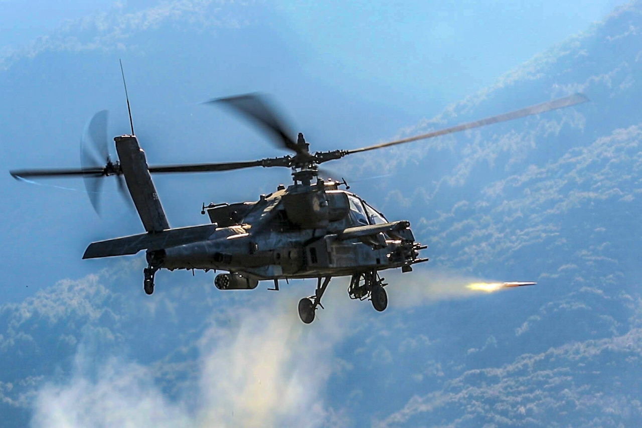 A helicopter fires a rocket.