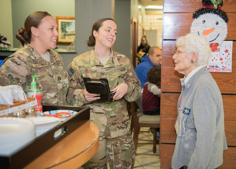 "Nancy Sahrbeck (right), USO Delaware volunteer, chats with traveling Airmen at the USO Delaware Terminal Community Center Jan. 18, 2019, at Dover Air Force Base, Delaware. The mission of the USO is ""connecting service members to family, home and country."" (U.S. Air Force photo by Mauricio Campino)"