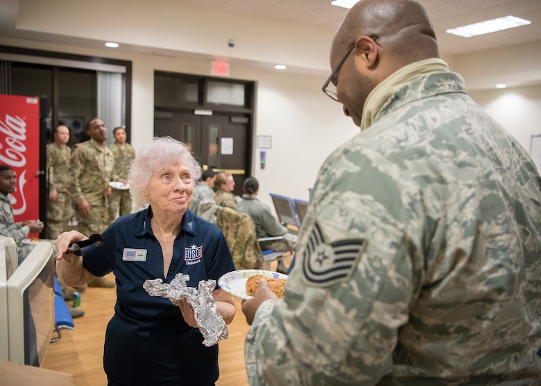 Josie Donithan, USO Delaware volunteer, serves fried chicken to honor guard team members and mortuary staff prior to a dignified transfer Jan. 24, 2019, at Dover Air Force Base, Delaware. USO Delaware served approximately 82,000 servicemembers and their families in 2018. (U.S. Air Force photo by Mauricio Campino)