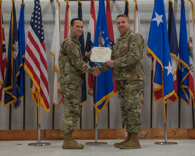U.S. Air Force Lt. Col. Toby Walker, 33rd Maintenance Group deputy commander, right, is awarded the Bronze Star by Col. Paul Moga, 33rd FW commander, during the 2018 Annual Awards Ceremony Jan. 25, 2019, at Eglin Air Force Base, Fla. While deployed to Iraq, Walker served as the 370th Air Expeditionary Advisory Group deputy commander. During his deployment, Walker led over 200 Airmen from 58 different Air Force specialties across six geographically separated locations in direct support of Operation INHERENT RESOLVE. (U.S. Air Force photo by Staff Sgt. Peter Thompson)