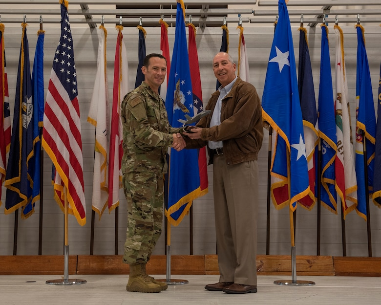 Mr. Jerry Williams, an outgoing member of the Air Education and Training Command commander's civic leader group, is presented with a token of appreciation by Col. Paul Moga, 33rd Fighter Wing commander, during the 2018 Annual Awards Ceremony Jan. 25, 2019, at Eglin Air Force Base, Fla. Williams selflessly devoted his time and resources to champion the needs of the 33rd FW at the major command level and provided support to the local AETC community. (U.S. Air Force photo by Staff Sgt. Peter Thompson)