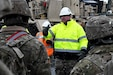 Capt. Stephen Yarbrough, 461st Expeditionary Terminal Operating Element team chief, briefs 1st Armored Brigade Combat Team, 1st Infantry Division Soldiers on what to expect in the equipment staging yard, Jan 22, 2019 at the Port of Antwerp, Belgium. (Photo Credit: Mr. Johnathon Orrell (SDDC))