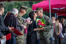 U.S. Marine Corps Col. Jay Hanlon, command inspector general, I Marine Expeditionary Force kisses his wife Heather Pauline Hanlon during his retirement ceremony at the Ranch House, Camp Pendleton, Calif., Jan 11, 2018.