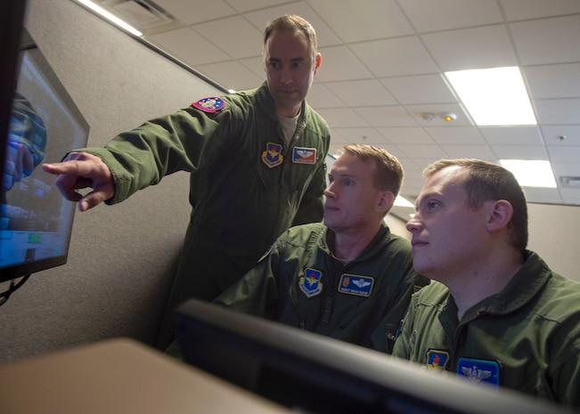 Instructors assigned to the 56th Air Refueling Squadron test the new KC-46 Pegasus PTT simulator, Dec. 20, 2019, at Altus Air Force Base, Okla. The KC-46 is the new in-air refueling aircraft purchased by the United States Air Force. (U.S. Air Force Photo by Senior Airman Jackson N. Haddon)