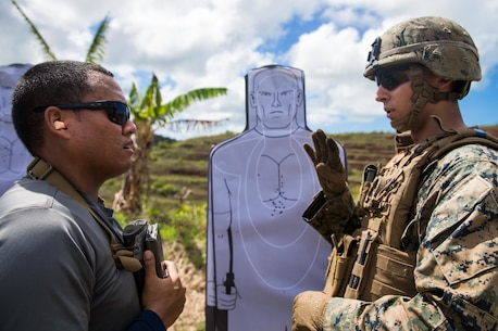 U.S. Marine Corps Lance Cpl. Jacob Coleman, a military policeman with Law Enforcement Detachment, Task Force Koa Moana, talks to an officer with Palau Police Force, during  a live-five training at Ngardmau, Republic of Palau, Nov. 28.