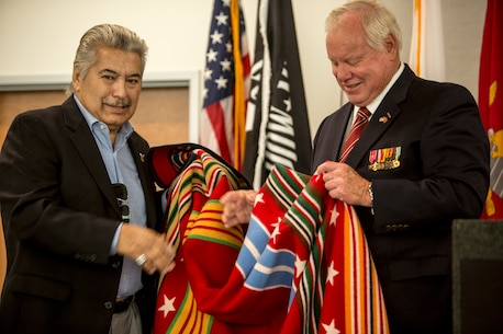 Retired Marine Corps Capt. Bill Horn receives a decorated robe as a token of appreciation for his military service at the North Inland Live Well Center in Escondido, Calif., Nov. 8, 2018.
