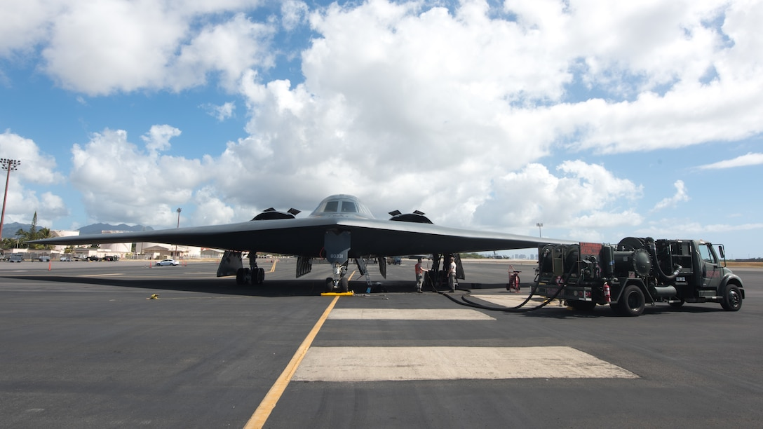 509th Logistics Readiness Squadron fuel distribution operators from Whiteman Air Force Base, Missouri ,conduct a hot-pit refueling on a B-2 Spirit Bomber at Joint Base Pearl Harbor-Hickam, Hawaii Jan. 22, 2019