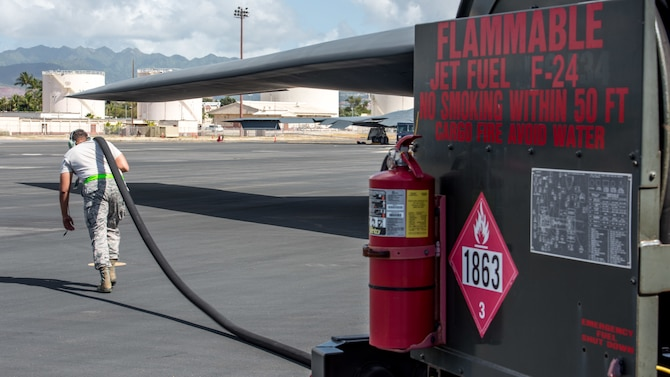 Tech. Sgt. Chad Jamerson, 509th Logistics Readiness Squadron fuel distribution operator deployed from Whiteman Air Force Base, Missouri, conducts a hot-pit refueling on a B-2 Spirit Bomber at Joint Base Pearl Harbor-Hickam, Hawaii Jan. 22, 2019.