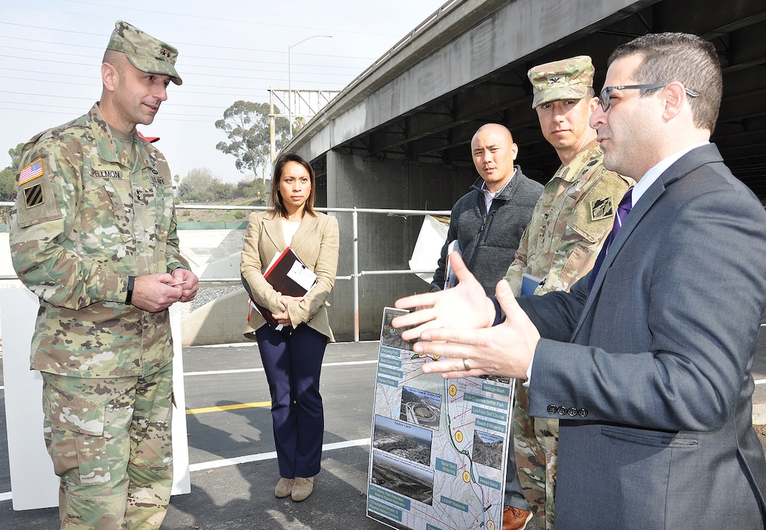 From left to right, Maj. Gen. Scott Spellmon, U.S. Army Corps of Engineers deputy commanding general for Civil and Emergency Operations; Lillian Doherty, LA District chief of the Operations Branch; Eric Nguyen, project manager, Operations Branch, and Col. Aaron Barta, LA District commander, listen to a Los Angeles city official talk about the LA River during a project tour Jan. 11 in Los Angeles.