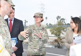 Brig. Gen. Kim Colloton, U.S. Army Corps of Engineers South Pacific Division commander, center, speaks about the LA River during a project tour for Maj. Gen. Scott Spellmon, U.S. Army Corps of Engineers deputy commanding general for Civil and Emergency Operations, left, Jan. 11 in Los Angeles, while David Van Dorpe, LA District deputy engineer and chief of the Programs and Project Management Division, and Lillian Doherty, LA District chief of the Operations Branch, look on.