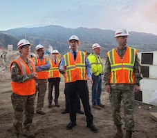Damien Lariviere, project manager, U.S. Army Corps of Engineers Los Angeles District, center, talks to Maj. Gen. Scott Spellmon, U.S. Army Corps of Engineers deputy commanding general for Civil and Emergency Operations, right, and Brig. Gen. Kim Colloton, South Pacific Division commander, left, about the Santa Ana River Mainstem project during a Jan. 9 tour of the Prado Dam basin.