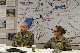 Maj. Gen. Scott Spellmon, U.S. Army Corps of Engineers deputy commanding general for Civil and Emergency Operations, left, and Brig. Gen. Kim Colloton, the Corps' South Pacific Division commander, right, listen to a brief about the Santa Ana River Mainstem project during a Jan. 9 tour of the Prado Dam basin.