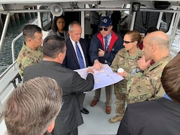 Maj. Gen. Scott Spellmon, U.S. Army Corps of Engineers deputy commanding general for Civil and Emergency Operations, second from right; Brig. Gen. Kim Colloton, South Pacific Division commander, third from right; and Col. Aaron Barta, LA District commander, third from left, receive a briefing about the ports of Los Angeles and Long Beach during a Jan. 10 boat tour around the ports.