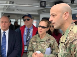 Maj. Gen. Scott Spellmon, U.S. Army Corps of Engineers deputy commanding general for Civil and Emergency Operations, right, and Brig. Gen. Kim Colloton, South Pacific Division commander, second from right, receive a briefing about the ports of Los Angeles and Long Beach during a Jan. 10 boat tour around the ports.