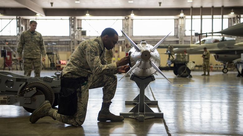 U.S. Air Force Senior Airman Mario Robinson, a 14th Aircraft Maintenance Unit weapons load crew member, inspects an inert munition during the fourth quarter weapons load competition at Misawa Air Base, Japan, Jan. 18, 2019. Team Misawa Airmen with the 35th Aircraft Maintenance Squadron take part in this friendly competition ensuring readiness and proper munition handling while racing against the clock. (U.S. Air Force photo by Airman 1st Class Collette Brooks)