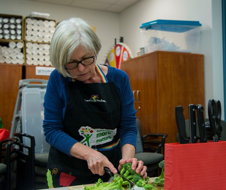 Kathy Steinbrecher, Red Cross volunteer, preps broccoli for a broccoli and cheese soup in the Airmen and Family Readiness Center at Scott Air Force Base, Ill., Jan. 18, 2019. The class is open to all members of Scott and gives participants ideas on what they can cook at home and an opportunity to taste the recipe.