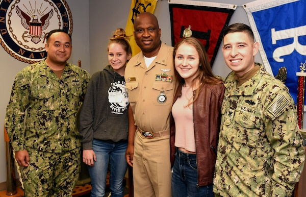 (From left) Chief Petty Officer Sambath Ham, Navy Recruiting Station North East; future Sailor Halle Von Plueren; Master Chief Petty Officer Matthew Maduemesi, chief recruiter of Navy Recruiting District San Antonio; future Sailor Hanna Von Plueren; and Petty Officer 2nd Class Francisco Sierra of NRS North East, pose for photos at NRD San Antonio headquarters at Joint Base San Antonio-Fort Sam Houston. Continuing a family tradition of military service, the Von Pluerens of San Antonio, who are fraternal twins, are joining America's Navy.