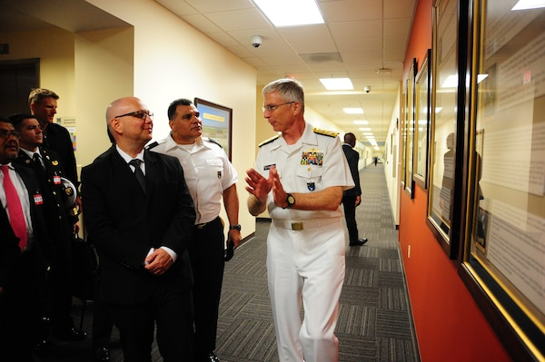 The commander of U.S. Southern Command, Navy Adm. Craig Faller, talks with Costa Rica's Minister of Public Security Michael Soto Rojas at SOUTHCOM headquarters.