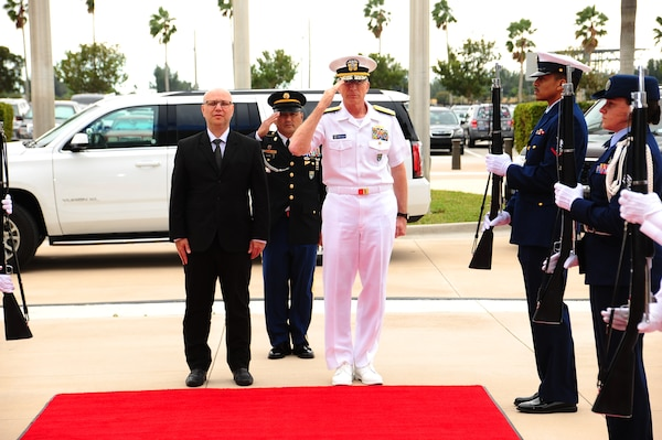 The commander of U.S. Southern Command, Navy Adm. Craig Faller, renders honors during the arrival of Costa Rica's Minister of Public Security, Michael Soto Rojas, to SOUTHCOM headquarters.