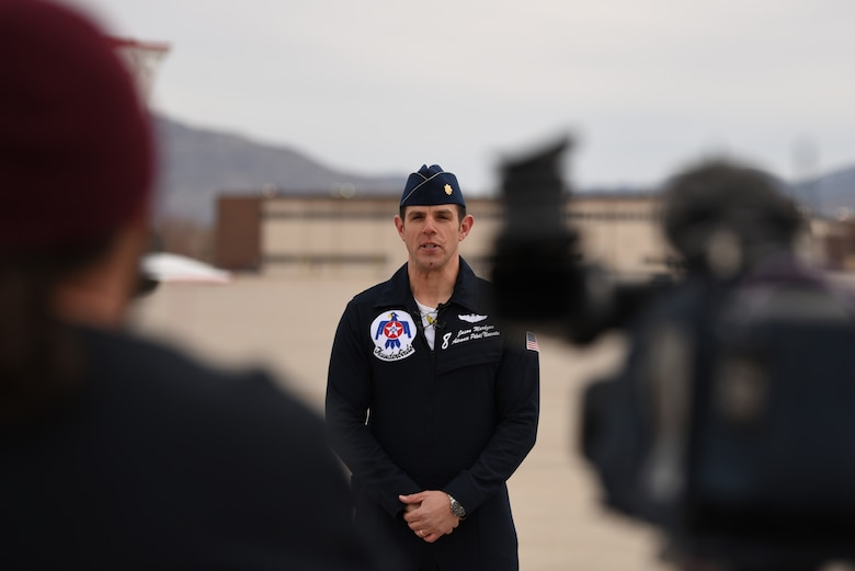 U.S. Air Force Maj. Jason Markzon, Thunderbird advance pilot and narrator, speaks to media at Kirtland Air Force Base, N.M., Jan. 29, 2019. The Thunderbirds are the Air Force's aerial demonstration team, and perform throughout the year at different locations. (U.S. Air Force photo by Senior Airman Eli Chevalier)