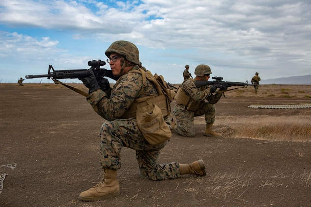 U.S. Marines with Service Company, 9th Communication Battalion, I Marine Expeditionary Force Information Group, provide security while awaiting the arrival of an aircraft during a casualty evacuation drill at Marine Corps Base Camp Pendleton, Oct. 2, 2018.