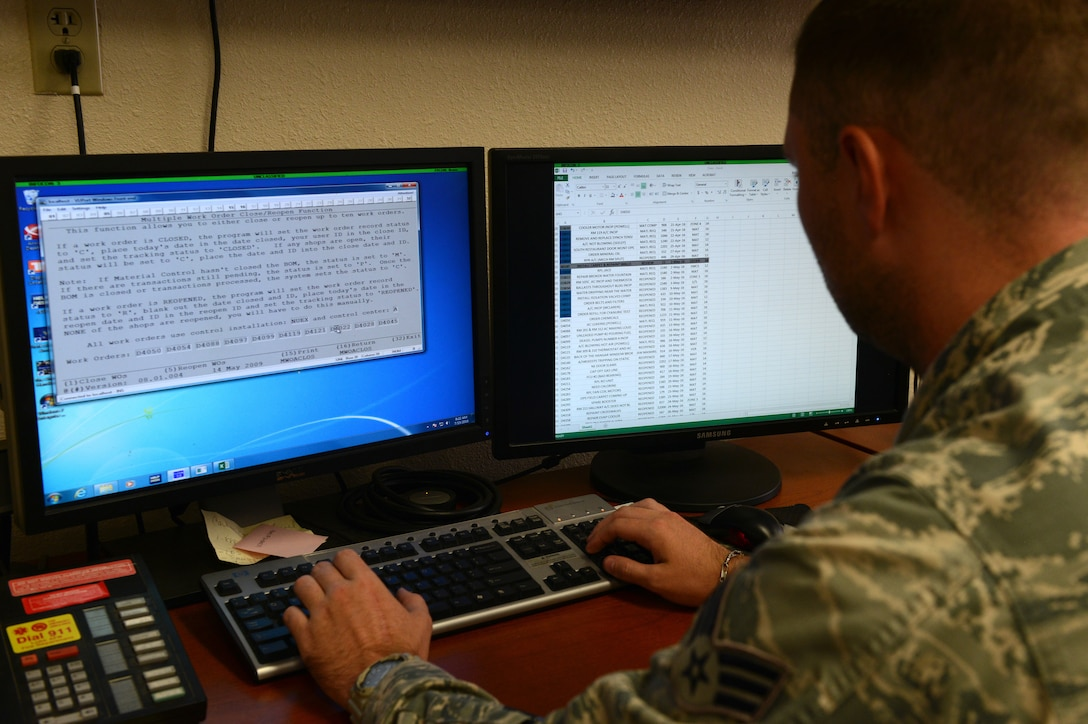 An Airman at Luke Air Force Base, Arizona, works on the Interim Work Information Management System, which was widely used by base civil engineers across the Air Force to track man hours, request parts and build maintenance schedules. The system is in the process of being replaced by NexGen IT. (U.S. Air Force photo by Senior Airman James Hensley)
