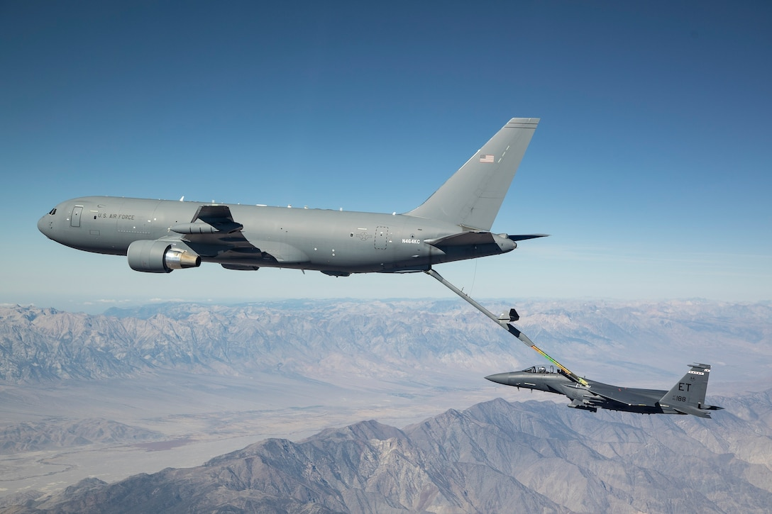 A new KC-46A Pegasus connects with an F-15 Strike Eagle for an aerial refueling test over California in 2018. (Courtesy photo by John D. Parker/Boeing)