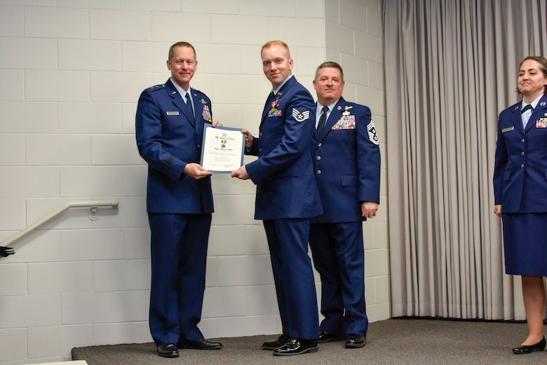 Staff Sgt. Sean Kornegay, 136th Airlift Wing Public Affairs broadcast journalist, receives a coin and certificate from Maj. Gen. David McMinn, commander of the Texas Air National Guard, and Chief Master Sgt. Christopher Castle, command chief of the TANG, during the Outstanding Airman of the Year award ceremony January 13, 2019 at Camp Mabry in Austin, Texas. Kornegay was one of five Airmen chosen to compete from the 136th Airlift Wing. (U.S. Air National Guard photo by Tech. Sgt. Katy Whitt)