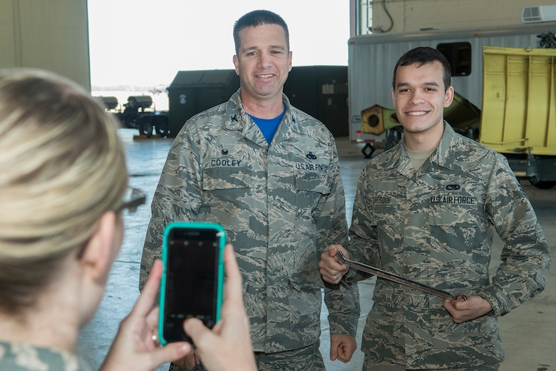 "U.S. Air Force Senior Airman Tyler Levesque poses for a picture with Col. Casey Cooley, 307th Maintenance Group commander, after receiving the ""Knuckle Buster"" award on Jan. 25, 2019, Barksdale Air Force Base, Louisiana. Levesque is assigned to the 2nd Maintenance Squadron and received the award for discovering that two control cables (the Lateral Control cable and the Drag Chute cable) on a B-52H Stratofortress were improperly routed. (U.S. Air Force photo by Greg Steele)"