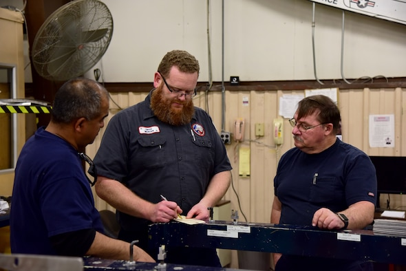 "David Mercer, a 47th Maintenance Directorate fabrication work lead, discusses shift assignments with his maintenance personnel staff at Laughlin Air Force Base, Texas, Jan. 28, 2019. Mercer was selected for the ""XLer of the Week"" for his help in overcoming structural maintenance obstacles, saving taxpayer dollars and training the next generation of maintenance professionals. (U.S. Air Force photo by Senior Airman John A. Crawford)"