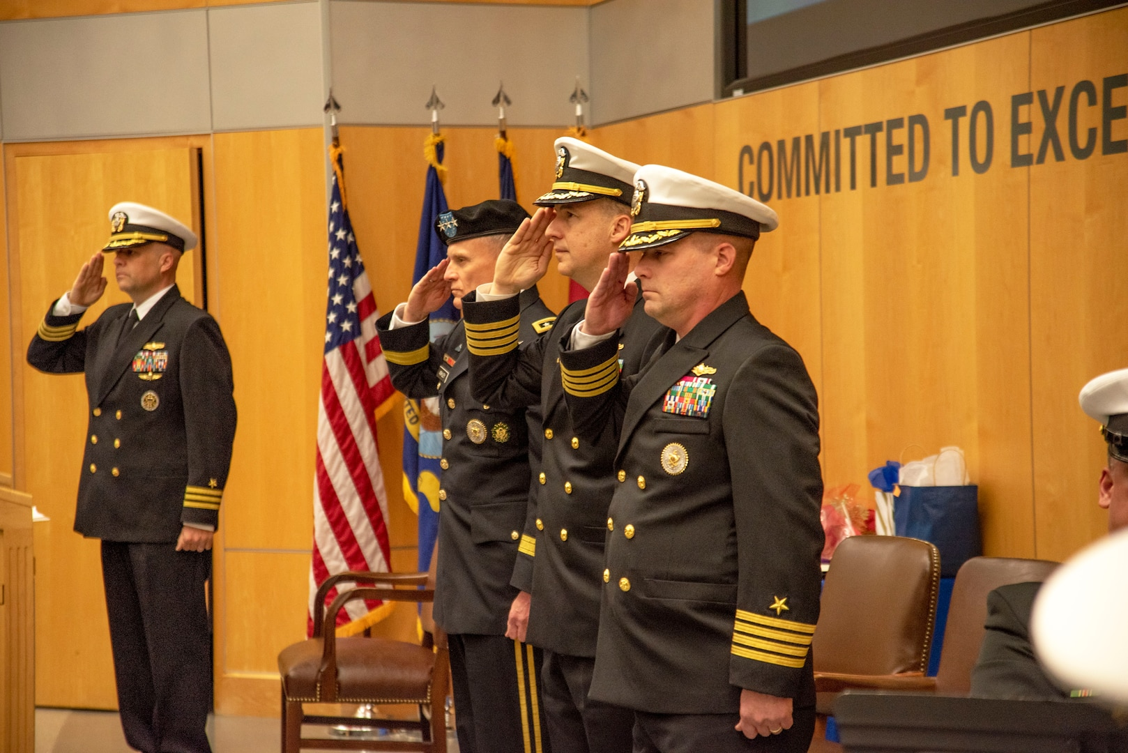 Defense Intelligence Agency Director Lt. Gen. Robert P. Ashley,. Jr., second from left, outgoing Defense Intelligence Agency Navy Element Commander Capt. Joshua C. Himes, second from right, and incoming Navy Element commander, Capt. Peter N. Shepard, right, salute during a change of command ceremony, Jan. 30, at the DIA headquarters on Joint Base Anacostia-Bolling.