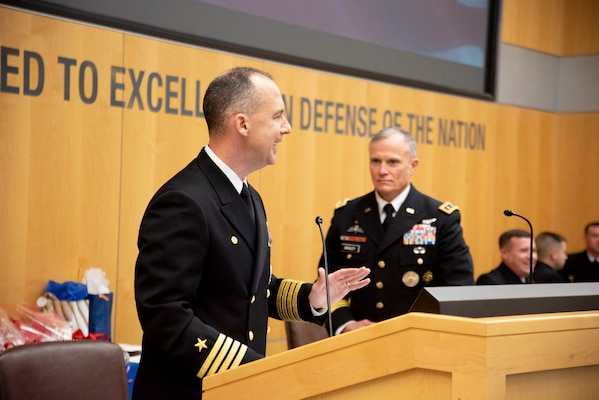 Outgoing Defense Intelligence Agency Navy Element Commander Capt. Joshua C. Himes (left) introduces the presiding officer, Defense Intelligence Agency Director Lt. Gen. Robert P. Ashley,. Jr., during a change of command ceremony, Jan. 30, at the DIA headquarters on Joint Base Anacostia-Bolling.